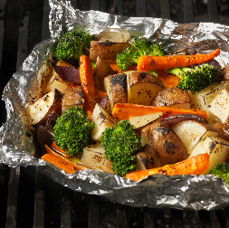 Tin Foil Dinner with potatoes, carrots, and broccoli.