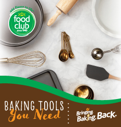 Baking tool essentials such as a whisk, measuring cups and spoons, spatulas, and a baking sheet.