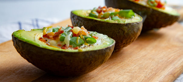 Open avocado with over-easy egg in the middle.