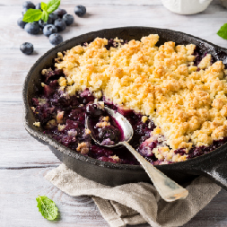 Dish of blueberry crumble