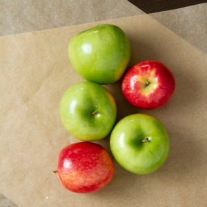 red and green apples on table