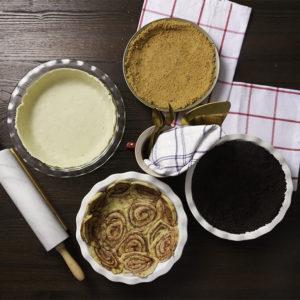 Cinnamon roll pie crust, oreo pie crust, classic pie crust, and graham cracker pie crust.