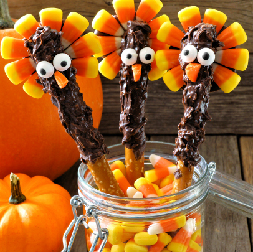 Stick Pretzels dipped in Chocolate and Candy Corn to make Thanksgiving Turkey Pretzels