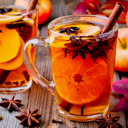 Mug of Mulled Citrus Cider with Lemon, Oranges, Apples, and Cinnamon