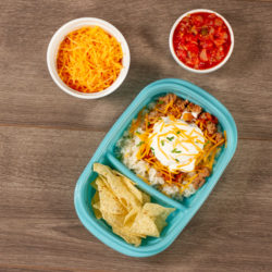 Ground Turkey with Cheese, Salsa, and Chips in a meal prep container