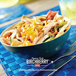 Bowtie and chicken pasta salad in a blue bowl
