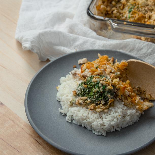 Broccoli chicken casserole on a plate over rice