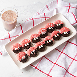 Cookies dipped in pink frosting with edible eyes