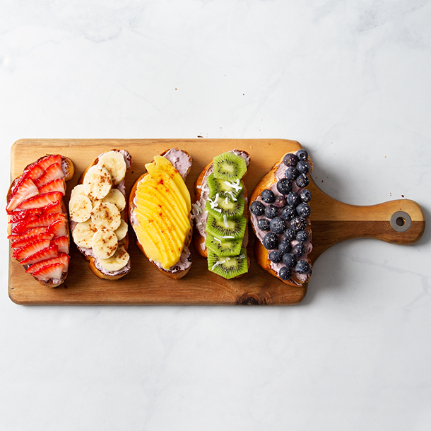 Rainbow toast with sliced fruit to make the colors