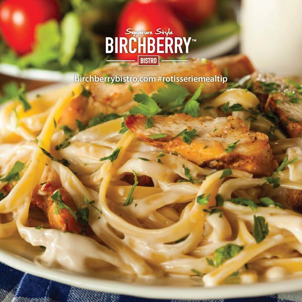 Rotisserie chicken fettuccine dish with garnish