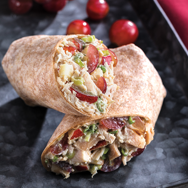 Chicken salad wrap with grapes on a counter