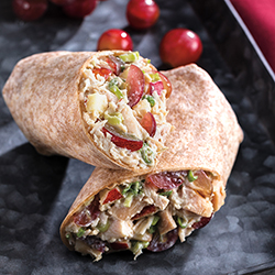 Chicken Salad Wrap with grapes on a dark counter