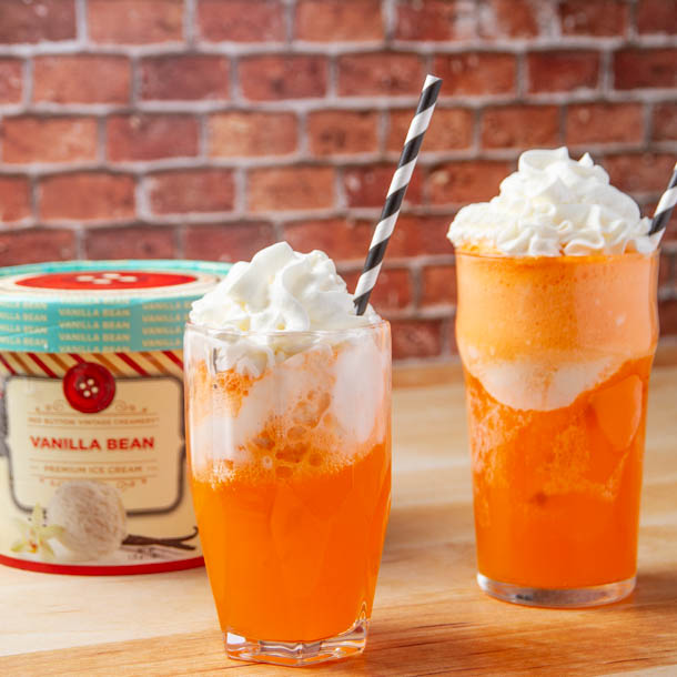Orange Soda Ice Cream Floats with Red Button Vanilla Bean Ice Cream Carton in the back