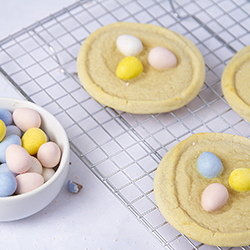sugar cookies with chocolate candy eggs on top