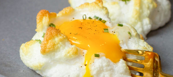 cloud eggs being cut into with fork