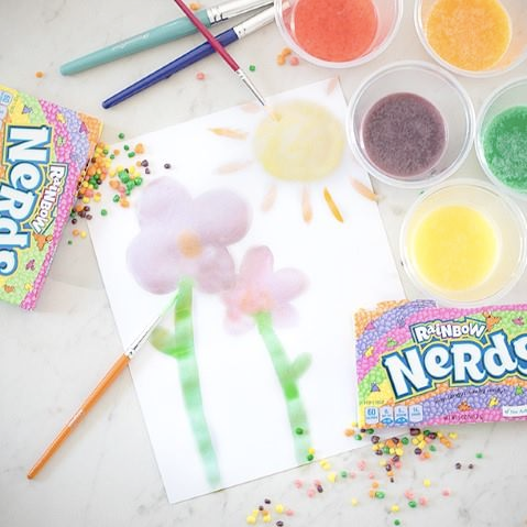 watercolor painting with nerds candy in cups with colors