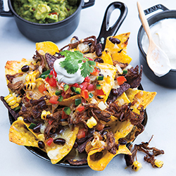 skillet nachos with beef salsa guacamole and beans