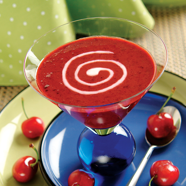 chilled cherry dessert in a martini glass with cherries spread around the bottom