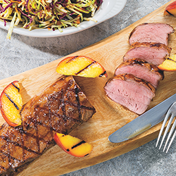 grilled pork tenderloin with peaches and slaw on the side