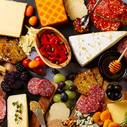 Charcuterie Board with Cheese, Meat, Fruit, and Spreads