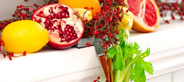 Lemon, orange, celery, pomegranate with holiday decor