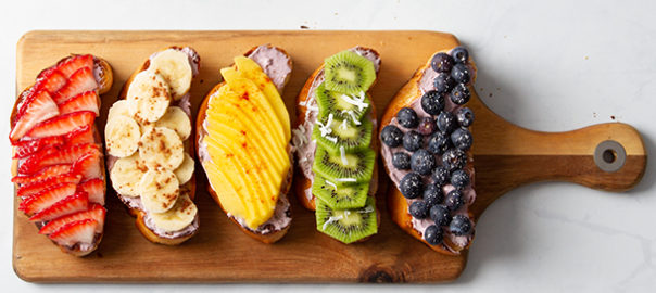 Rainbow colored pieces of toast with fruit