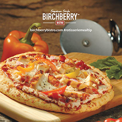 bbq chicken pizza on a cutting board with a pizza slicer, garnish, and the Birchberry Bistro logo at the top