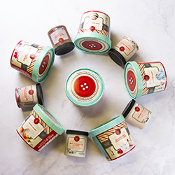 red button vintage creamery in a circle on marble counter