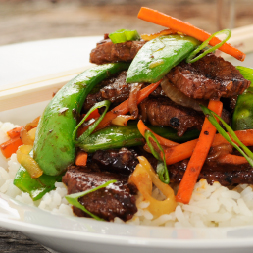 snap pea and beef stir fry over white rice