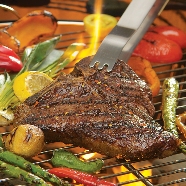 Steak and vegetables on a grill